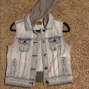 Sleeveless distressed jean jacket.